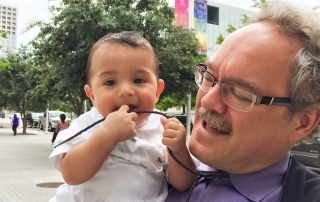 Mitch with his grandson Henry Luis